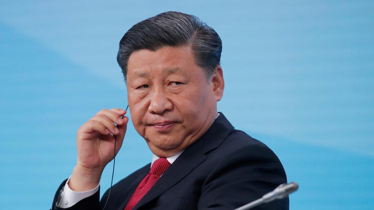 Portrait de Xi Jinping dans une conférence internationale.