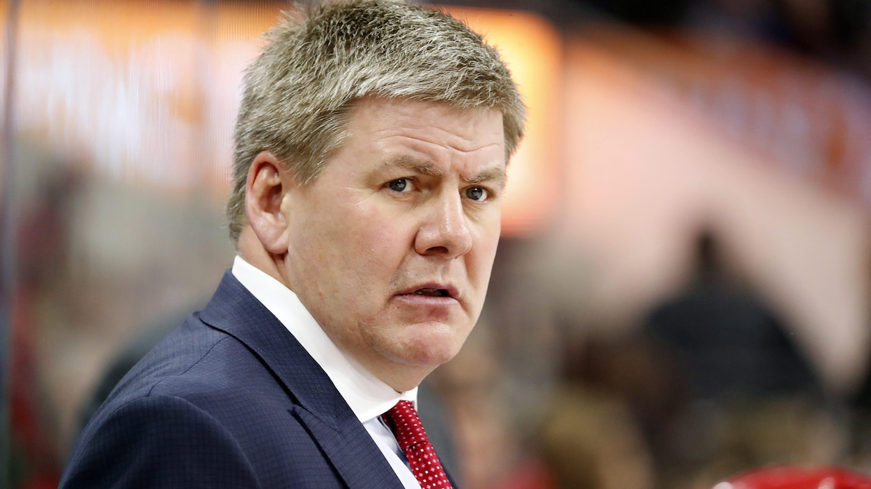 Carolina Hurricanes head coach Bill Peters watches from the bench during the first period of an NHL hockey game between the Carolina Hurricanes and the Colorado Avalanche, Saturday, Feb. 10, 2018, in Raleigh, N.C. (AP Photo/Karl B DeBlaker)