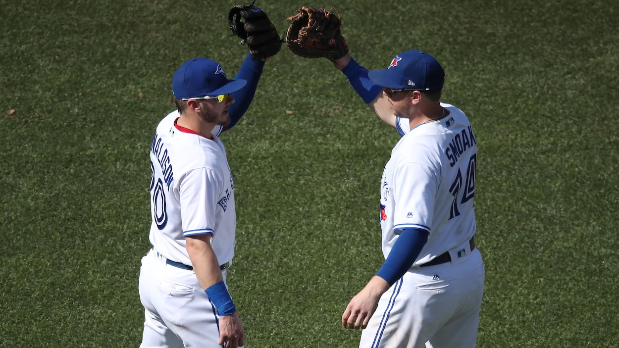 Josh Donaldson (no 20) et Justin Smoak (no 14)