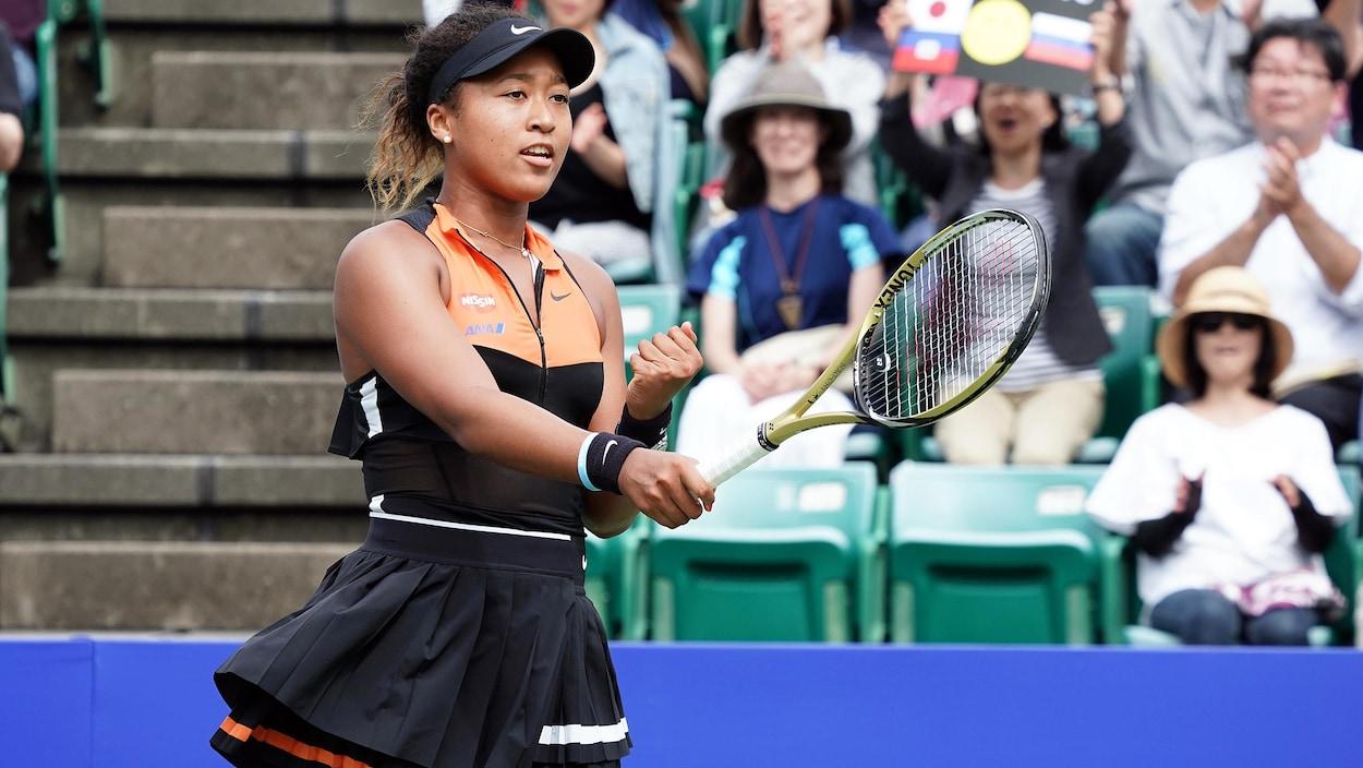 Elle serre le poing pour célébrer sa victoire à Osaka.