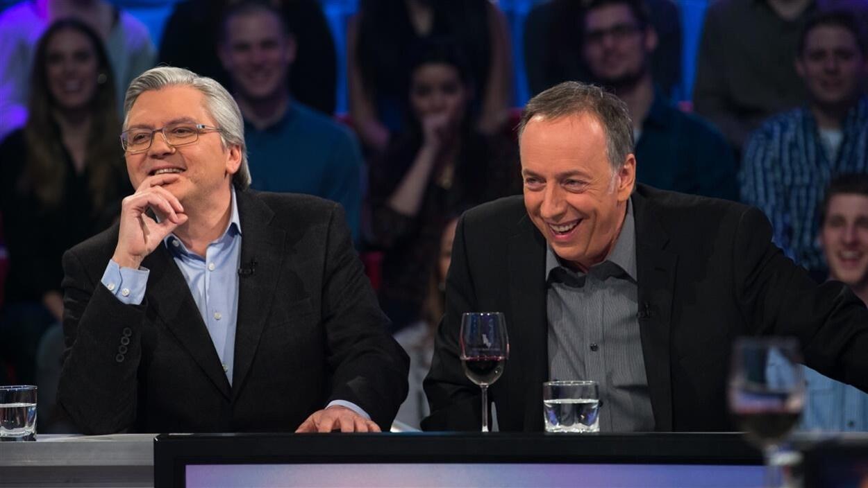 Richard Martineau et Benoit Dutrizac rient.
