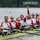 Lisa Roman, Kasia Gruchalla-Wesierski, Christine Roper, Andrea Proske, Susanne Grainger, Madison Mailey, Sydney Payne, Avalon Wasteneys and Kristen Kit of Canada celebrate winning the gold medal in the women's rowing eight final at the 2020 Summer Olympics, Friday, July 30, 2021, in Tokyo, Japan. (AP Photo/Lee Jin-man)