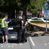 An ICBC driver examiner, left, wears a face mask, safety glasses and gloves while speaking to a driver after a road test in Richmond, B.C., on Monday, July 20, 2020. Non-commercial road tests resumed in the province on Monday after approximately 55,000 appointments were cancelled due to COVID-19. ICBC is planning on hiring and training more examiners and opening additional testing locations to deal with the backlog. THE CANADIAN PRESS/Darryl Dyck