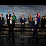A picture of the eight Arctic foreign ministers and leaders of the six Arctic indigenous groups on a stage.
