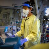 Dr. Ayesha Khory is pictured in the moments before intubating a COVID-19 patient in an Alberta intensive care unit. Unions representing health-care workers say support from the military and Red Cross is necessary. Dr. Ayesha Khory is pictured in the moments before intubating a COVID-19 patient in an Alberta intensive care unit. Unions representing health-care workers say support from the military and Red Cross is necessary.