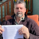 Aaron Penman holds one of the court documents a paralegal claimed had been filed with an Alberta court, only to discover the court had no record of it.