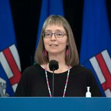 Alberta's health-care system has to start preparing for other health challenges, such as the seasonal flu, said chief medical officer of health Dr. Deena Hinshaw.