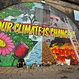 Urban art laying  at Glasgow laying out a message : Our climate is changing.