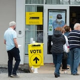 People line up to vote in the advance polls for the federal election on Friday, Sept. 10, in Chambly, Que.