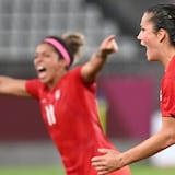 Jessie Fleming, right, celebrates after scoring the opening goal for Canada during the Tokyo 2020 Olympic Games women's semifinal soccer match on Monday.