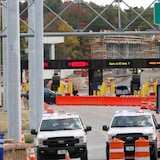 A sign says the U.S. border is closed to non-essential traffic at the Thousand Islands Bridge in Lansdowne, Ont., on Sept. 28.