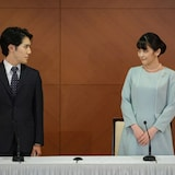 Japan's former princess Mako, right, the elder daughter of Prince Akishino and Princess Kiko, and her husband Kei Komuro, whom she originally met while at university, pose at the start of a news conference to announce their marriage registration, at the Grand Arc Hotel in Tokyo.