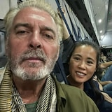 Selfie of David Lavery and Junping Zhang-Lavery sitting in German airlift after leaving Kabul Airport.