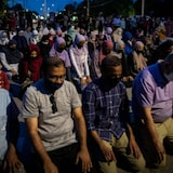 People pray following a vigil attended by thousands in London, Ont., for a family of four killed in an attack police say was motivated by anti-Muslim hate.