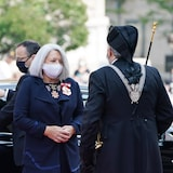 Mary Simon gets out of a car and  is greeted by the Usher of the Black Rod as she arrives at the installation ceremony in Ottawa.