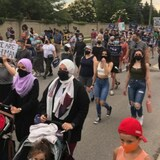Thousands of people gather for a march last month in London, Ont., as a multi-faith show of solidarity for the Afzaal family, four of whom were killed June 6 in a hit-and-run that police say was motivated by anti-Muslim hate. On Monday, the National Council of Canadian Muslims released dozens of policy recommendations to counter Islamophobia.