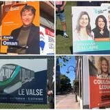 Des pancartes de quatre différents partis de la ville de Québec.