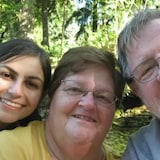 Rebecca Dixon, left, is shown with her parents, Davina and Dan. The family members are named as the lead plaintiffs on a class-action lawsuit against disgraced fertility doctor Norman Barwin.