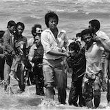 A picture taken in the late 1970s shows a group of refugees who arrived in Malaysia on a small boat that sank a few metres from shore. The flight of Vietnamese refugees began after the fall of Saigon in 1975. In spite of the dangers of unfriendly waters and piracy, tens of thousands took the South China Sea. By 1978, the exodus had grown to dramatic proportions.