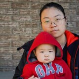 Yuanyuan Zhou has cared for her baby Vincent alone since he was born in June 2020. During the pandemic, she's been separated from her parents and her seven-year-old son Damello, who remain in China.