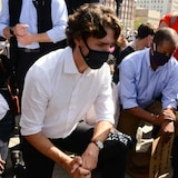 Prime Minister Justin Trudeau takes a knee during an eight-minute, 46-second silence held during an anti-racism protest on Parliament Hill during the COVID-19 pandemic in Ottawa on Friday, June 5, 2020.