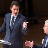Liberal Leader Justin Trudeau, left, and Conservative Leader Stephen Harper take part in the 2015 Munk debate on foreign policy.