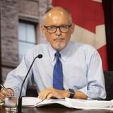 Dr Kieran Moore.