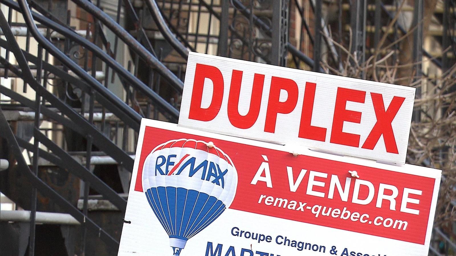 Pancarte « Duplex à vendre »