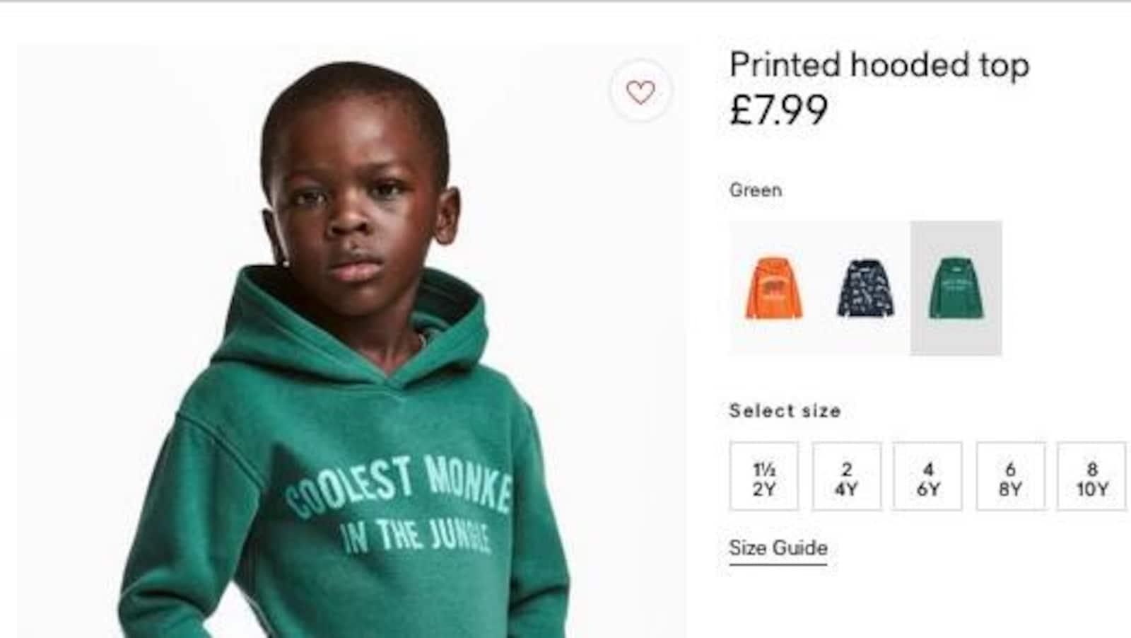 Photographie d'un jeune garçon noir portant un chandail vert.