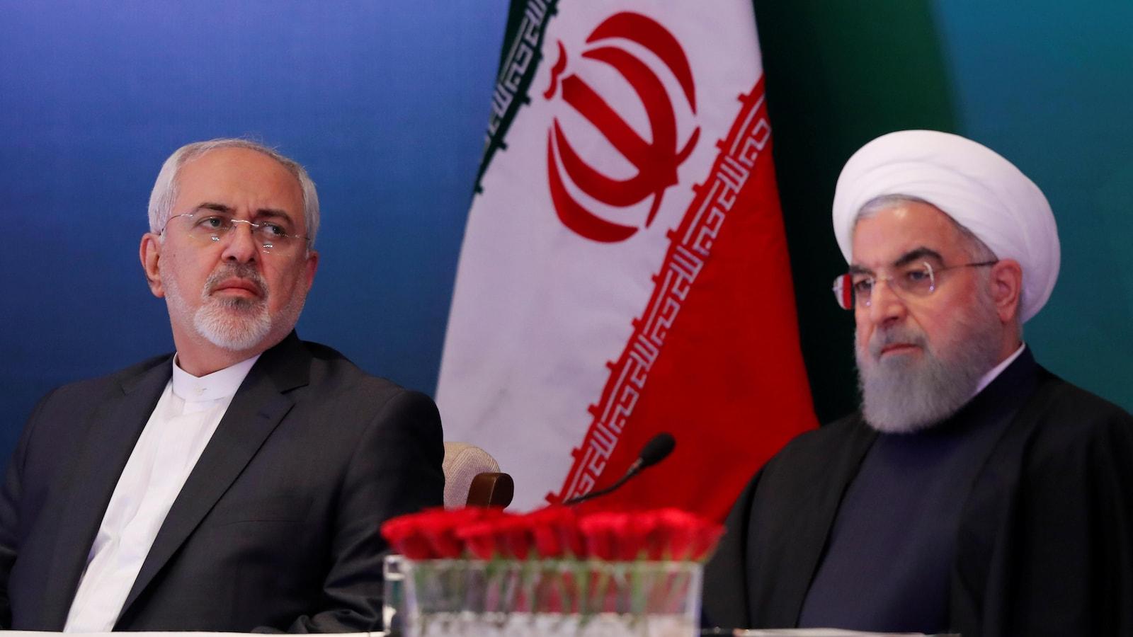 Le ministre iranien des Affaires étrangères et le président de l'Iran lors d'une rencontre.
