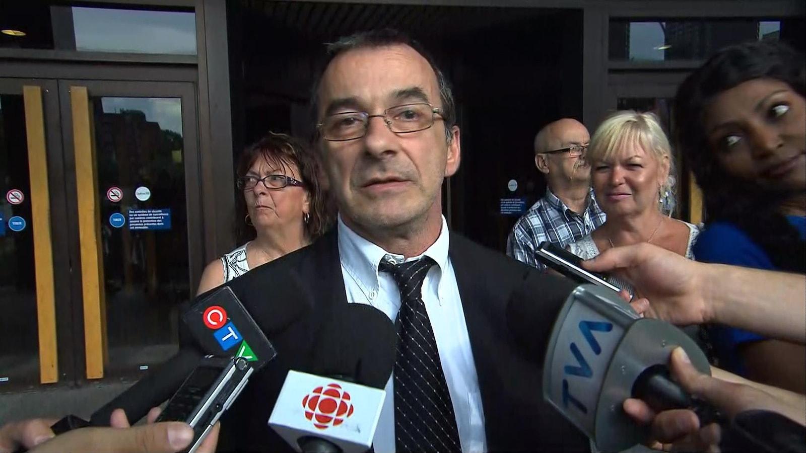 Michel Cadotte a accordé une courte entrevue aux journalistes à sa sortie du palais de justice de Montréal, vendredi le 7 juillet 2017.