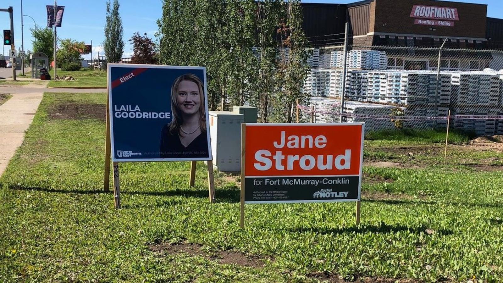 Des pancartes électorales pour la candidate du PCU, Laila Goodridge, et celle du NPD, Jane Stroud.