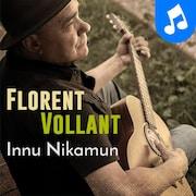 Photo de Florent Vollant, jouant de la guitar.