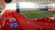 Dessin de l'intérieur d'un grand complexe sportif avec un stade de soccer, une piste d'athlétisme, une piste de vélo.