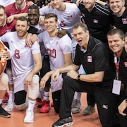 Canada men's national volleyball team poses with a Daruma Doll after winning the NORCECA 2020 Olympic qualification tournament at the Pacific Coliseum and earning a spot at the 2020 Summer Olympic Games in Vancouver on Sunday, January 12, 2020. THE CANADIAN PRESS/Richard Lam