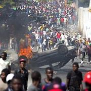 Des manifestants à Port-au-Prince réclament la démission du président Jovenel Moïse.