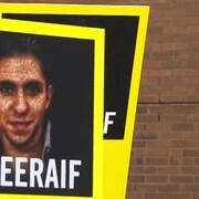 Affiche du visage de Raïf Badawi avec le hashtag #freeraif écrit en bas