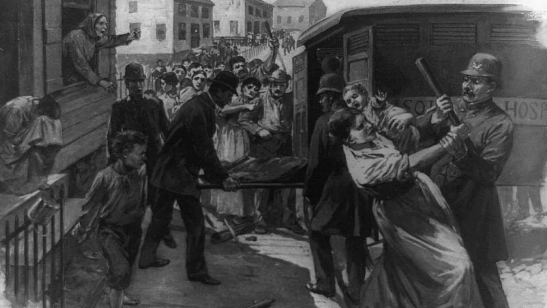 Des immigrants résistent aux policiers alors qu'on s'apprête à emmener leurs enfants dans un fourgon de l'hôpital.