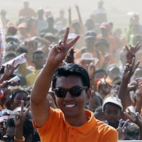 FILE - In this Monday, Dec. 17, 2018 file photo presidential candidate Andry Rajoelina waves at supporters as he arrives to address an election rally in Antananarivo, Madagascar. Madagascar's electoral commission has announced provisional results in the runoff presidential election, saying Rajoelina received more than 55 percent of the vote while Marc Ravalomanana received more than 44 percent. (AP Photo/Themba Hadebe, File)