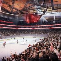 Des spectateurs assistent à une partie de hockey dans le futur aréna de Seattle.