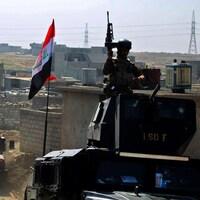 Les forces irakiennes circulent dans Mossoul-Ouest jeudi, après y avoir reconquis d'autres quartiers la veille.