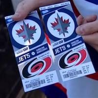 Des billets pour un match des Jets de Winnipeg.