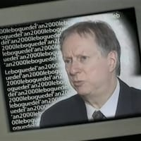 Montage d'un écran d'ordinateur avec l'expression «Le bogue de l'an 2000» se répétant à l'infini.