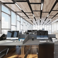 Des bureaux avec des ordinateurs