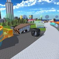 Vue aérienne du campus virtuel avec des édifices de toutes les couleurs et une route.