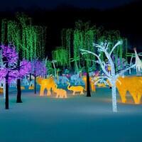 un paysage d'animaux et d'arbres illuminés et multicolores, figés dans la neige