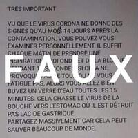 Une feuille où sont écrits des conseils sur le coronavirus. Le mot FAUX est écrit sur la publication.