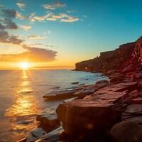 Coucher de soleil près d'une falaise rouge de l'Île-du-Prince-Édouard.