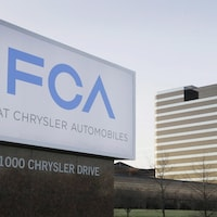 FILE - This Tuesday, May 6, 2014, file photo shows a sign outside Fiat Chrysler Automobiles world headquarters in Auburn Hills, Mich. In a lawsuit filed Tuesday, May 23, 2017, the U.S. government is suing Fiat Chrysler, alleging that some diesel pickup trucks and Jeeps cheat on emissions tests. (AP Photo/Carlos Osorio, File)
