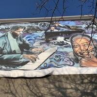 Une fresque murale dans La Petite-Bourgogne montrant des musiciens.